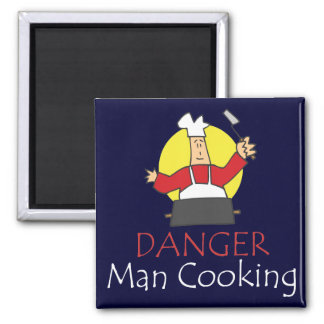 Aimant de cuisine d'homme de danger