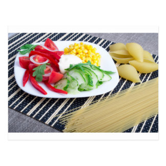 Closeup view of a vegetarian dish of raw vegetable postcard