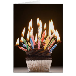Cupcake with birthday candles greeting card