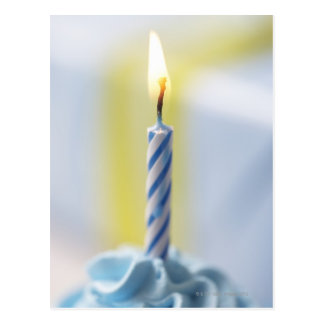 Cupcake with candle, close-up (focus on flame) postcard