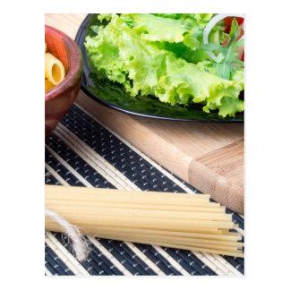 Diagonal composition on a table with a fresh salad postcard