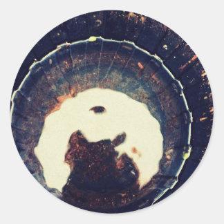 Disturbed waters round sticker