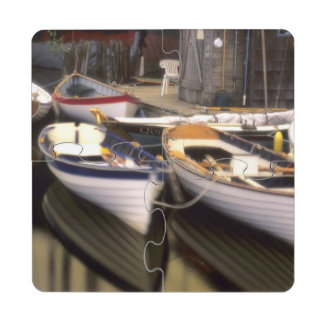 Fog surrounds four boats docked. drink coaster puzzle