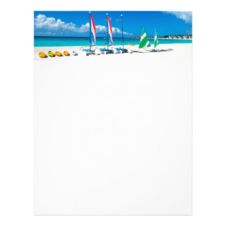 Resort's beach with boats on it letterhead template