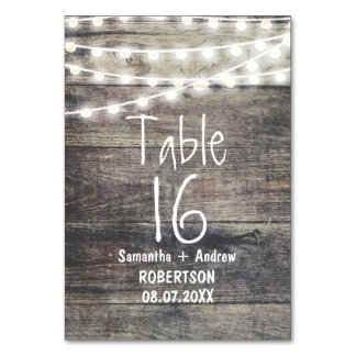 Rustic wood and string lights table number table card