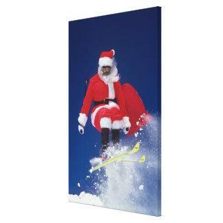 Santa Claus on skis jumping off a cornice at Canvas Prints
