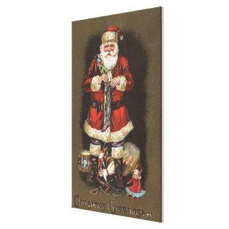 Santa Stuffing Stocking with Nutcracker Gallery Wrap Canvas