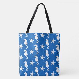 Seahorse & starfish - white on cobalt blue tote bag