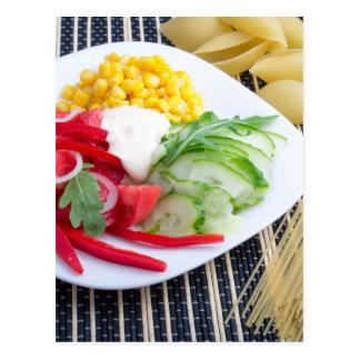 Slices of fresh raw vegetables postcard