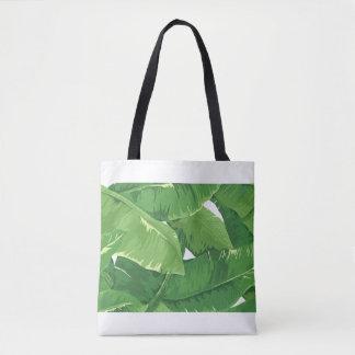 Tropical overlapping banana leaves tote bag