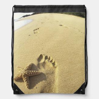 USA, Hawaii, Maui, Makena Beach, Footprint and Drawstring Backpacks