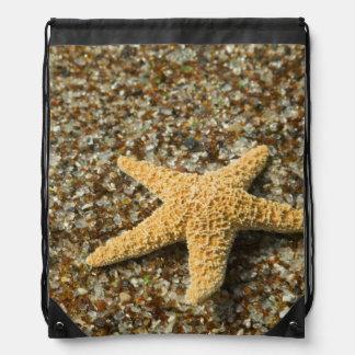 USA, HI, Kauai, Glass Beach with Star fish Drawstring Backpacks