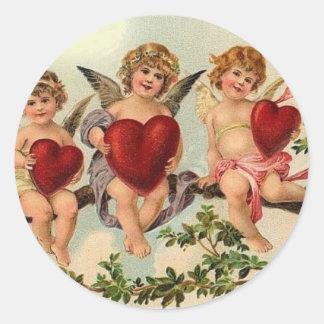 `Victorian valentine cuipid Sticker's Round Sticker