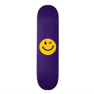 Winking smiley face skate decks